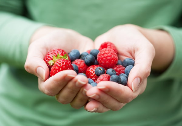 hands-holding-mixed-berries