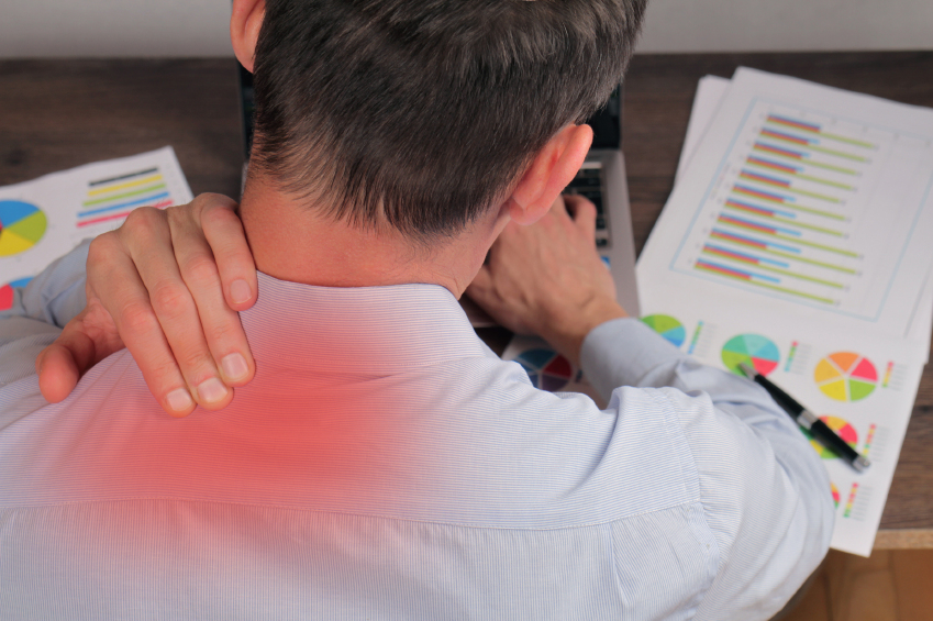 Man with back pain. Business man rubbing his painful neck close up